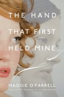 Cover of the book The hand that first held mine