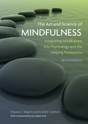 Book cover for The art and science of mindfulness : integrating mindfulness into psychology and the helping professions / Shauna L. Shapiro and Linda E. Carlson &#59; with a foreword by Jon Kabat-Zinn