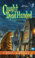 Cover image for Caught dead handed / Carol J. Perry.