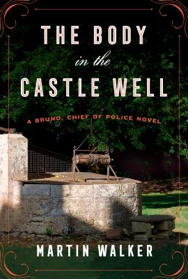 Cover image for The body in the castle well : a Bruno, chief of police novel / Martin Walker.