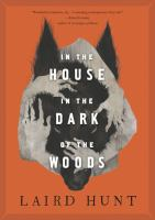 Cover image for In the house in the dark of the woods [large print] / Laird Hunt.
