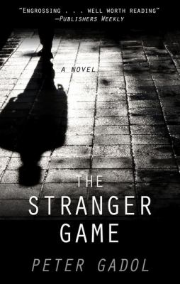 Cover image for The stranger game [large print] / Peter Gadol.