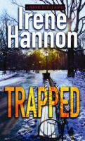 Cover image for Trapped [large print] / Irene Hannon.