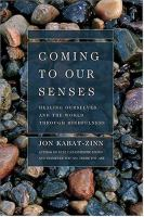 Cover image for Coming to our senses : healing ourselves and the world through mindfulness