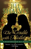 Cover image for The trouble with mistletoe. bk. 2 [large print] : Heartbreaker Bay series