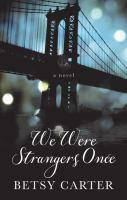 Cover image for We were strangers once [large print]