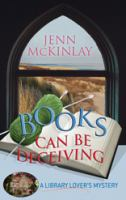 Cover image for Books can be deceiving. bk. 1 Library lover's mystery series