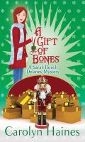 Cover image for A gift of bones. bk. 19 [large print] : Sarah Booth Delaney series