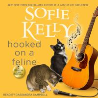 Cover image for Hooked on a feline Magical cats series, book 13.