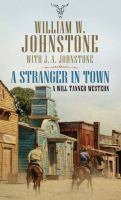 Cover image for A stranger in town. bk. 2 [large print] : Will Tanner, U.S. Deputy Marshal series