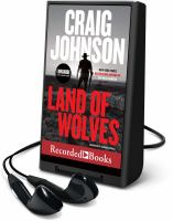 Cover image for Land of wolves. bk. 15 [Playaway] : Walt Longmire series