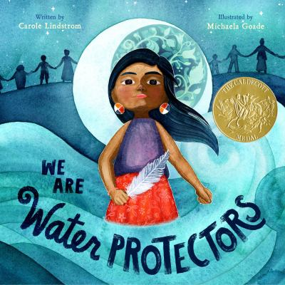 The cover of the book We Are Water Protectors by Carole Lindstrom features a young Native American girl holding a feather and standing in swirls of water.