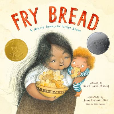The book cover of Fry Bread by Kevin Noble Maillard features a Native American woman holding a child. The child is eating fry bread.